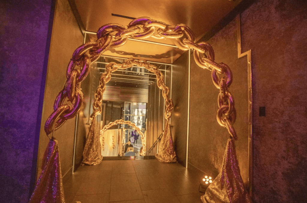 Golden Balloon and Drapery Party Entrance