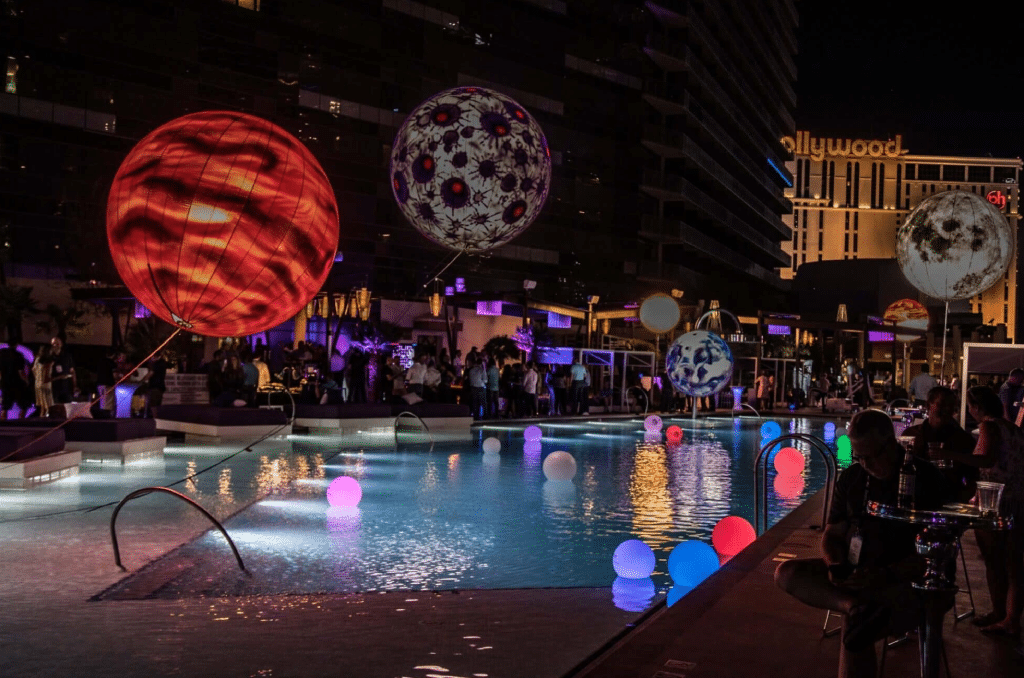 Large Corporate Event Pool Party with LED Orbs and Large Balloons